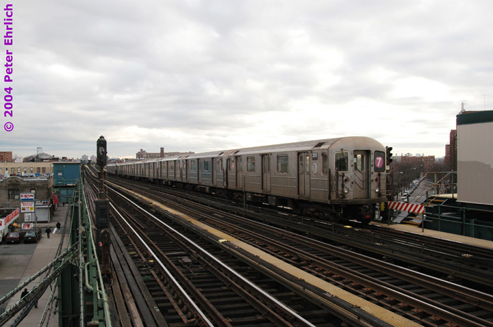 (134k, 720x478)<br><b>Country:</b> United States<br><b>City:</b> New York<br><b>System:</b> New York City Transit<br><b>Line:</b> IRT Flushing Line<br><b>Location:</b> 90th Street/Elmhurst Avenue <br><b>Route:</b> 7<br><b>Car:</b> R-62A (Bombardier, 1984-1987)  2113 <br><b>Photo by:</b> Peter Ehrlich<br><b>Date:</b> 12/25/2003<br><b>Viewed (this week/total):</b> 0 / 2875