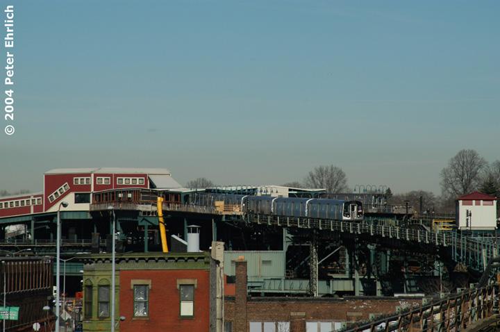 (115k, 720x478)<br><b>Country:</b> United States<br><b>City:</b> New York<br><b>System:</b> New York City Transit<br><b>Line:</b> BMT Canarsie Line<br><b>Location:</b> Broadway Junction <br><b>Route:</b> L<br><b>Car:</b> R-143 (Kawasaki, 2001-2002) 8256 <br><b>Photo by:</b> Peter Ehrlich<br><b>Date:</b> 12/28/2003<br><b>Viewed (this week/total):</b> 0 / 4740