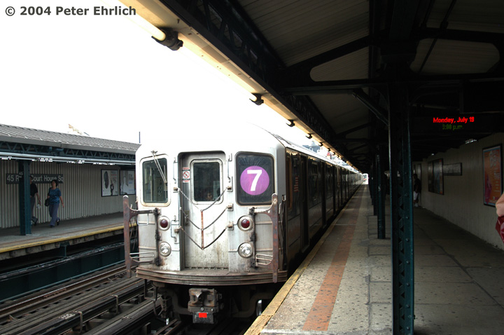(119k, 720x478)<br><b>Country:</b> United States<br><b>City:</b> New York<br><b>System:</b> New York City Transit<br><b>Line:</b> IRT Flushing Line<br><b>Location:</b> Court House Square/45th Road <br><b>Route:</b> 7<br><b>Car:</b> R-62A (Bombardier, 1984-1987)  2077 <br><b>Photo by:</b> Peter Ehrlich<br><b>Date:</b> 7/19/2004<br><b>Viewed (this week/total):</b> 3 / 2472