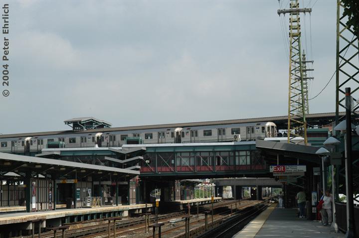 (125k, 720x478)<br><b>Country:</b> United States<br><b>City:</b> New York<br><b>System:</b> New York City Transit<br><b>Line:</b> IRT Flushing Line<br><b>Location:</b> 61st Street/Woodside <br><b>Route:</b> 7<br><b>Car:</b> R-62A (Bombardier, 1984-1987)  2077 <br><b>Photo by:</b> Peter Ehrlich<br><b>Date:</b> 7/19/2004<br><b>Notes:</b> View from the LIRR platform.<br><b>Viewed (this week/total):</b> 0 / 3197