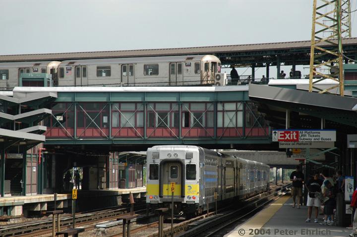 (156k, 720x478)<br><b>Country:</b> United States<br><b>City:</b> New York<br><b>System:</b> New York City Transit<br><b>Line:</b> IRT Flushing Line<br><b>Location:</b> 61st Street/Woodside <br><b>Route:</b> 7<br><b>Car:</b> R-62A (Bombardier, 1984-1987)  2111 <br><b>Photo by:</b> Peter Ehrlich<br><b>Date:</b> 7/19/2004<br><b>Notes:</b> View from the LIRR platform, with push-pull LIRR diesel train cab car 5017.<br><b>Viewed (this week/total):</b> 0 / 9706