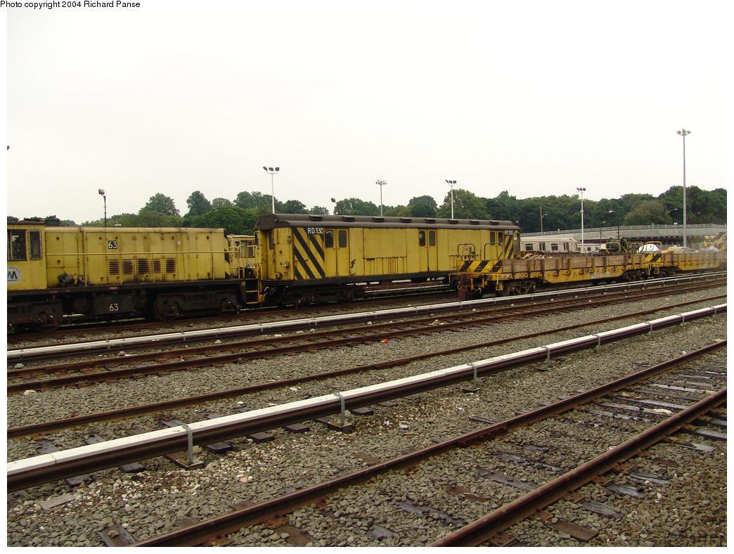 (199k, 1044x788)<br><b>Country:</b> United States<br><b>City:</b> New York<br><b>System:</b> New York City Transit<br><b>Location:</b> 36th Street Yard<br><b>Car:</b> R-47 Locomotive  63 <br><b>Photo by:</b> Richard Panse<br><b>Date:</b> 7/18/2004<br><b>Notes:</b> With R14 RD330 (ex-5857)<br><b>Viewed (this week/total):</b> 1 / 3523