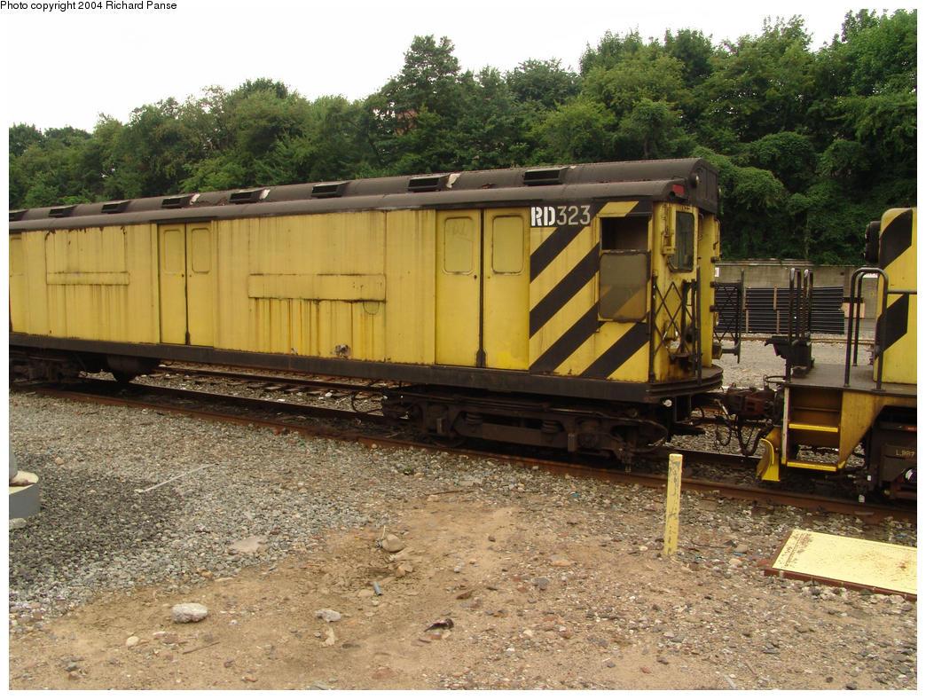 (214k, 1044x788)<br><b>Country:</b> United States<br><b>City:</b> New York<br><b>System:</b> New York City Transit<br><b>Location:</b> 36th Street Yard<br><b>Car:</b> R-71 Rider Car (R-17/R-21/R-22 Rebuilds)  RD323 (ex-5877)<br><b>Photo by:</b> Richard Panse<br><b>Date:</b> 7/18/2004<br><b>Viewed (this week/total):</b> 5 / 3311