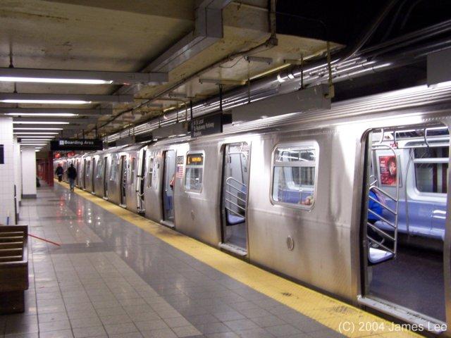 (61k, 640x480)<br><b>Country:</b> United States<br><b>City:</b> New York<br><b>System:</b> New York City Transit<br><b>Line:</b> BMT Canarsie Line<br><b>Location:</b> 8th Avenue <br><b>Route:</b> L<br><b>Car:</b> R-143 (Kawasaki, 2001-2002)  <br><b>Photo by:</b> James Lee<br><b>Date:</b> 6/25/2004<br><b>Viewed (this week/total):</b> 1 / 6713