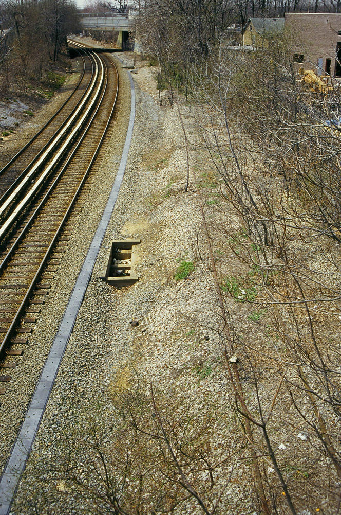 (300k, 664x1001)<br><b>Country:</b> United States<br><b>City:</b> New York<br><b>System:</b> New York City Transit<br><b>Line:</b> SIRT<br><b>Location:</b> Nassau <br><b>Photo by:</b> Marc Pitanza<br><b>Date:</b> 4/7/2004<br><b>Notes:</b> Freight siding visible buried at right, facing south toward Tottenville.<br><b>Viewed (this week/total):</b> 0 / 4937