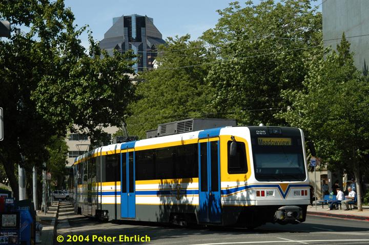 (217k, 720x478)<br><b>Country:</b> United States<br><b>City:</b> Sacramento, CA<br><b>System:</b> SACRT Light Rail<br><b>Location:</b> 8th & O <br><b>Car:</b> Sacramento CAF LRV  225 <br><b>Photo by:</b> Peter Ehrlich<br><b>Date:</b> 6/28/2004<br><b>Notes:</b> Train has just turned north onto 8th Street and will stop at Capitol before turning back on K Street.<br><b>Viewed (this week/total):</b> 2 / 1388