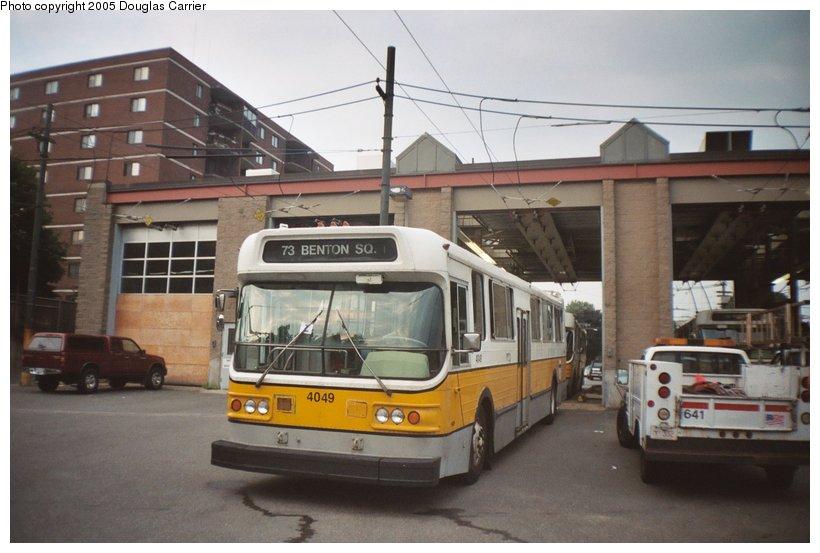 (107k, 820x553)<br><b>Country:</b> United States<br><b>City:</b> Boston, MA<br><b>System:</b> MBTA Boston<br><b>Line:</b> MBTA Trolleybus (71,72,73)<br><b>Location:</b> North Cambridge Car House<br><b>Car:</b> MBTA Trolleybus 4049 <br><b>Photo by:</b> Douglas Carrier<br><b>Date:</b> 9/2004<br><b>Notes:</b> 4049 was prepped for scrap but was later reinstated into service.<br><b>Viewed (this week/total):</b> 0 / 3673