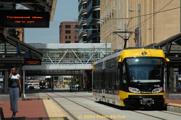 (165k, 720x478)<br><b>Country:</b> United States<br><b>City:</b> Minneapolis, MN<br><b>System:</b> MNDOT Light Rail Transit<br><b>Line:</b> Hiawatha Line<br><b>Location:</b> <b><u>Government Plaza </b></u><br><b>Car:</b> Bombardier Flexity Swift  111 <br><b>Photo by:</b> Peter Ehrlich<br><b>Date:</b> 8/2/2004<br><b>Notes:</b> View north along S. 5th Street from Government Plaza Station..<br><b>Viewed (this week/total):</b> 0 / 1968