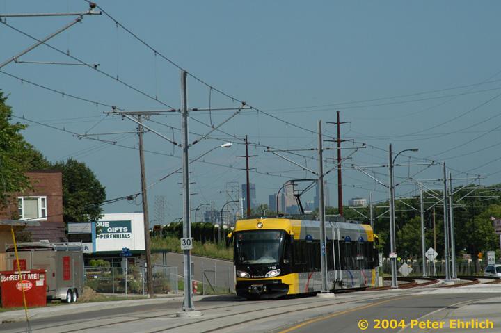 (133k, 720x479)<br><b>Country:</b> United States<br><b>City:</b> Minneapolis, MN<br><b>System:</b> MNDOT Light Rail Transit<br><b>Line:</b> Hiawatha Line<br><b>Location:</b> Minnehaha Avenue/52nd Street <br><b>Car:</b> Bombardier Flexity Swift  111 <br><b>Photo by:</b> Peter Ehrlich<br><b>Date:</b> 8/2/2004<br><b>Notes:</b> At 52nd Street, the line turns off of Hiawatha Blvd. and onto Minnehaha Avenue for a few blocks of street running.<br><b>Viewed (this week/total):</b> 0 / 1666