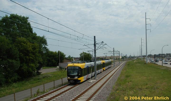 (128k, 720x426)<br><b>Country:</b> United States<br><b>City:</b> Minneapolis, MN<br><b>System:</b> MNDOT Light Rail Transit<br><b>Line:</b> Hiawatha Line<br><b>Location:</b> South of Franklin Avenue <br><b>Car:</b> Bombardier Flexity Swift  112 <br><b>Photo by:</b> Peter Ehrlich<br><b>Date:</b> 8/2/2004<br><b>Notes:</b> South of the pedestrian bridge, the line goes onto a viaduct to cross bustling Route 55, which is the numeric line designation for the Hiawatha LRT.<br><b>Viewed (this week/total):</b> 1 / 2142