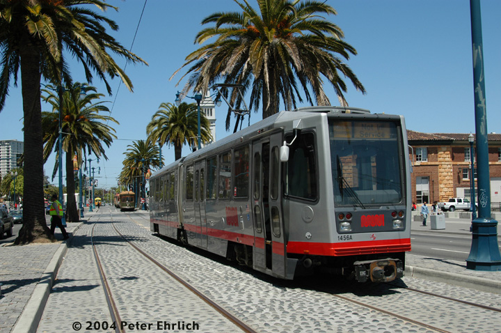 (189k, 720x478)<br><b>Country:</b> United States<br><b>City:</b> San Francisco/Bay Area, CA<br><b>System:</b> SF MUNI<br><b>Location:</b> Embarcadero/Mission<br><b>Car:</b> SF MUNI Breda LRV 1456 <br><b>Photo by:</b> Peter Ehrlich<br><b>Date:</b> 5/12/2004<br><b>Notes:</b> The presence of a Breda in the vicinity of the Ferry Building is extremely rare.  1456 is on a training assignment.  Vintage cars such as New Orleans 952 are in the background.<br><b>Viewed (this week/total):</b> 1 / 1167