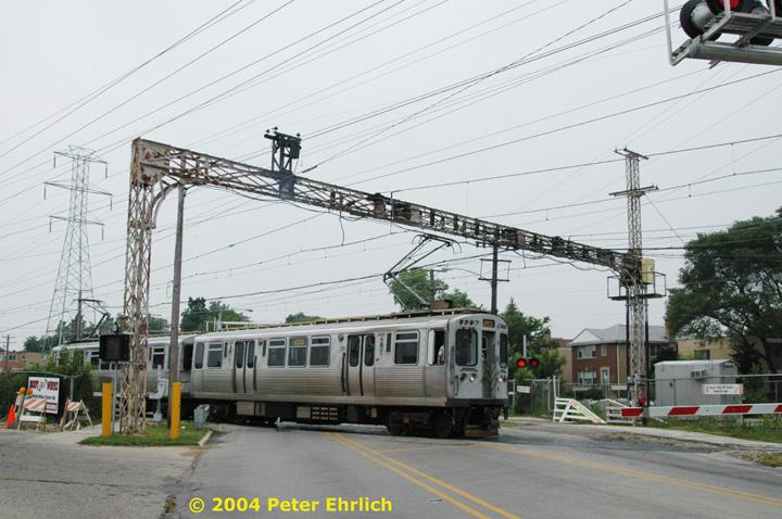 (150k, 720x478)<br><b>Country:</b> United States<br><b>City:</b> Chicago, IL<br><b>System:</b> Chicago Transit Authority<br><b>Line:</b> CTA Yellow (Skokie)<br><b>Location:</b> Niles Center Road<br><b>Car:</b> CTA 3200 Series 3450 <br><b>Photo by:</b> Peter Ehrlich<br><b>Date:</b> 7/30/2004<br><b>Viewed (this week/total):</b> 0 / 3210
