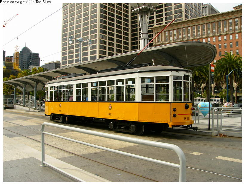 (125k, 820x620)<br><b>Country:</b> United States<br><b>City:</b> San Francisco/Bay Area, CA<br><b>System:</b> SF MUNI<br><b>Location:</b> Embarcadero/Ferry Building <br><b>Route:</b> F-Market<br><b>Car:</b> Milan Milano/Peter Witt (1927-1930)  1811 <br><b>Photo by:</b> Ted Siuta<br><b>Date:</b> 8/22/2004<br><b>Viewed (this week/total):</b> 0 / 789