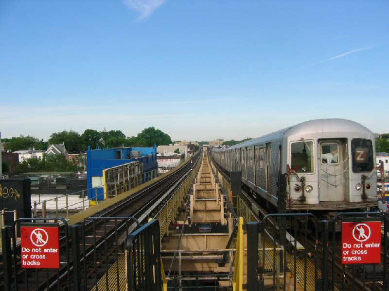 (99k, 800x600)<br><b>Country:</b> United States<br><b>City:</b> New York<br><b>System:</b> New York City Transit<br><b>Line:</b> BMT Nassau Street/Jamaica Line<br><b>Location:</b> Alabama Avenue <br><b>Route:</b> Z<br><b>Car:</b> R-42 (St. Louis, 1969-1970)   <br><b>Photo by:</b> Dante D. Angerville<br><b>Date:</b> 5/20/2004<br><b>Viewed (this week/total):</b> 0 / 4381