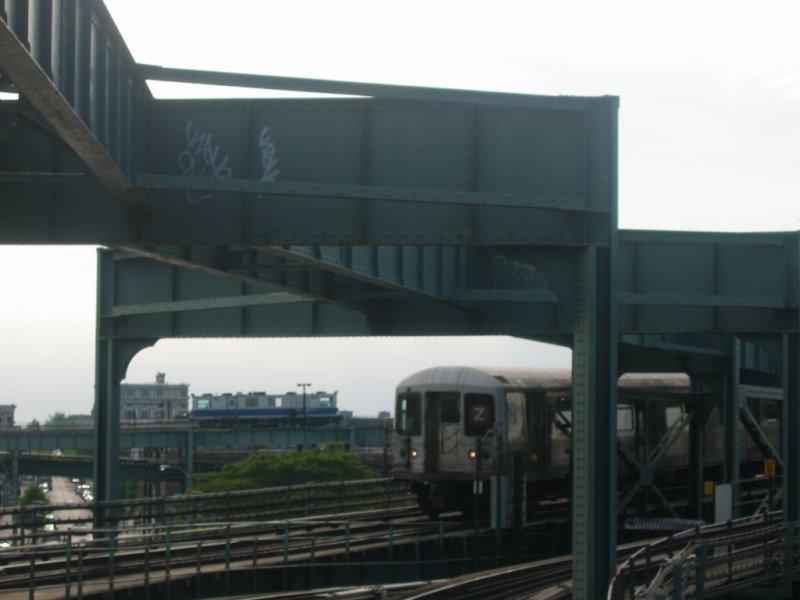 (52k, 800x600)<br><b>Country:</b> United States<br><b>City:</b> New York<br><b>System:</b> New York City Transit<br><b>Line:</b> BMT Nassau Street/Jamaica Line<br><b>Location:</b> Alabama Avenue <br><b>Route:</b> Z<br><b>Car:</b> R-42 (St. Louis, 1969-1970)   <br><b>Photo by:</b> Dante D. Angerville<br><b>Date:</b> 5/20/2004<br><b>Notes:</b> Note track geometry car in background on Canarsie line.<br><b>Viewed (this week/total):</b> 0 / 5378