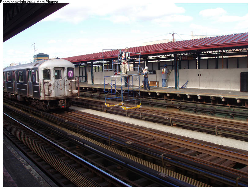 (106k, 820x620)<br><b>Country:</b> United States<br><b>City:</b> New York<br><b>System:</b> New York City Transit<br><b>Line:</b> IRT Flushing Line<br><b>Location:</b> 74th Street/Broadway <br><b>Car:</b> R-62A (Bombardier, 1984-1987)  2082 <br><b>Photo by:</b> Marc Pitanza<br><b>Date:</b> 10/11/2004<br><b>Notes:</b> Note platform repair work utilizing a special scaffold meant to ride the rails.<br><b>Viewed (this week/total):</b> 1 / 3875