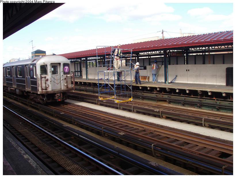 (106k, 820x620)<br><b>Country:</b> United States<br><b>City:</b> New York<br><b>System:</b> New York City Transit<br><b>Line:</b> IRT Flushing Line<br><b>Location:</b> 74th Street/Broadway <br><b>Car:</b> R-62A (Bombardier, 1984-1987)  2082 <br><b>Photo by:</b> Marc Pitanza<br><b>Date:</b> 10/11/2004<br><b>Notes:</b> Note platform repair work utilizing a special scaffold meant to ride the rails.<br><b>Viewed (this week/total):</b> 0 / 3863