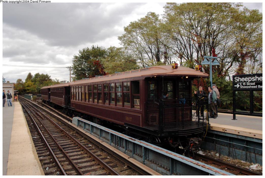 (217k, 1044x701)<br><b>Country:</b> United States<br><b>City:</b> New York<br><b>System:</b> New York City Transit<br><b>Line:</b> BMT Brighton Line<br><b>Location:</b> Sheepshead Bay <br><b>Route:</b> Fan Trip<br><b>Car:</b> BMT Elevated Gate Car 1407 <br><b>Photo by:</b> David Pirmann<br><b>Date:</b> 10/23/2004<br><b>Viewed (this week/total):</b> 1 / 3795