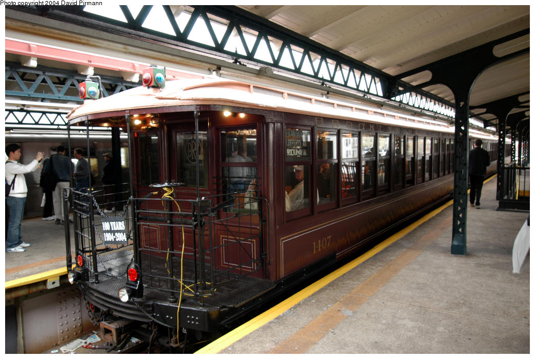 (190k, 1044x701)<br><b>Country:</b> United States<br><b>City:</b> New York<br><b>System:</b> New York City Transit<br><b>Line:</b> BMT Astoria Line<br><b>Location:</b> Astoria Boulevard/Hoyt Avenue <br><b>Route:</b> Fan Trip<br><b>Car:</b> BMT Elevated Gate Car 1407 <br><b>Photo by:</b> David Pirmann<br><b>Date:</b> 10/29/2004<br><b>Notes:</b> BU train in excursion service on Astoria line.<br><b>Viewed (this week/total):</b> 0 / 3351