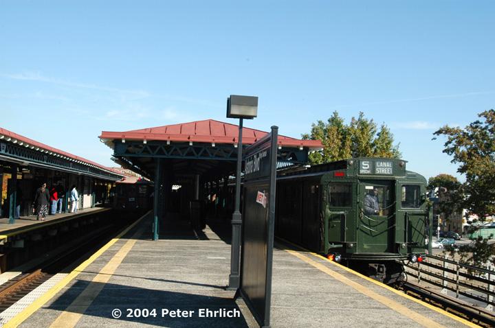 (141k, 720x478)<br><b>Country:</b> United States<br><b>City:</b> New York<br><b>System:</b> New York City Transit<br><b>Line:</b> BMT Astoria Line<br><b>Location:</b> Astoria Boulevard/Hoyt Avenue<br><b>Route:</b> Fan Trip<br><b>Car:</b> BMT Elevated Gate Car 1407 <br><b>Photo by:</b> Peter Ehrlich<br><b>Date:</b> 10/28/2004<br><b>Notes:</b> BU train in excursion service on Astoria line.<br><b>Viewed (this week/total):</b> 0 / 2887