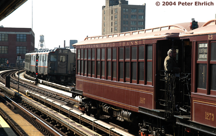 (168k, 720x454)<br><b>Country:</b> United States<br><b>City:</b> New York<br><b>System:</b> New York City Transit<br><b>Line:</b> BMT Astoria Line<br><b>Location:</b> 39th/Beebe Aves. <br><b>Route:</b> Fan Trip<br><b>Car:</b> BMT Elevated Gate Car 1407 <br><b>Photo by:</b> Peter Ehrlich<br><b>Date:</b> 10/28/2004<br><b>Notes:</b> BU train in excursion service on Astoria line.<br><b>Viewed (this week/total):</b> 0 / 3341