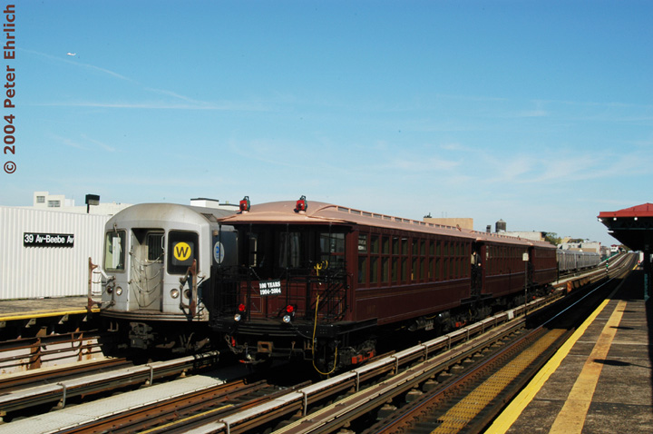 (133k, 720x478)<br><b>Country:</b> United States<br><b>City:</b> New York<br><b>System:</b> New York City Transit<br><b>Line:</b> BMT Astoria Line<br><b>Location:</b> 39th/Beebe Aves. <br><b>Route:</b> Fan Trip<br><b>Car:</b> BMT Elevated Gate Car 1407 <br><b>Photo by:</b> Peter Ehrlich<br><b>Date:</b> 10/28/2004<br><b>Notes:</b> BU train in excursion service on Astoria line.<br><b>Viewed (this week/total):</b> 4 / 2968