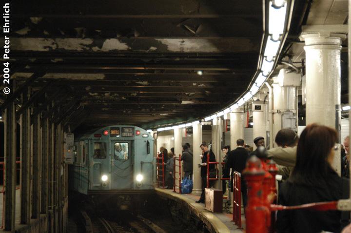(140k, 720x478)<br><b>Country:</b> United States<br><b>City:</b> New York<br><b>System:</b> New York City Transit<br><b>Line:</b> IRT Times Square-Grand Central Shuttle<br><b>Location:</b> Times Square <br><b>Route:</b> Museum Train Service (S)<br><b>Car:</b> R-33 World's Fair (St. Louis, 1963-64) 9306 <br><b>Photo by:</b> Peter Ehrlich<br><b>Date:</b> 10/27/2004<br><b>Notes:</b> Train in regular passenger service, technically not a fan trip.<br><b>Viewed (this week/total):</b> 2 / 5162