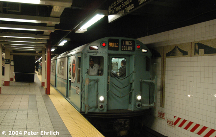 (132k, 720x458)<br><b>Country:</b> United States<br><b>City:</b> New York<br><b>System:</b> New York City Transit<br><b>Line:</b> IRT Times Square-Grand Central Shuttle<br><b>Location:</b> Grand Central <br><b>Route:</b> Fan Trip<br><b>Car:</b> R-33 World's Fair (St. Louis, 1963-64) 9306 <br><b>Photo by:</b> Peter Ehrlich<br><b>Date:</b> 10/27/2004<br><b>Artwork:</b> <i>Arches, Towers, Pyramids</i>, Jackie Ferrara (1997).<br><b>Notes:</b> Train in regular passenger service, technically not a fan trip.<br><b>Viewed (this week/total):</b> 0 / 4220