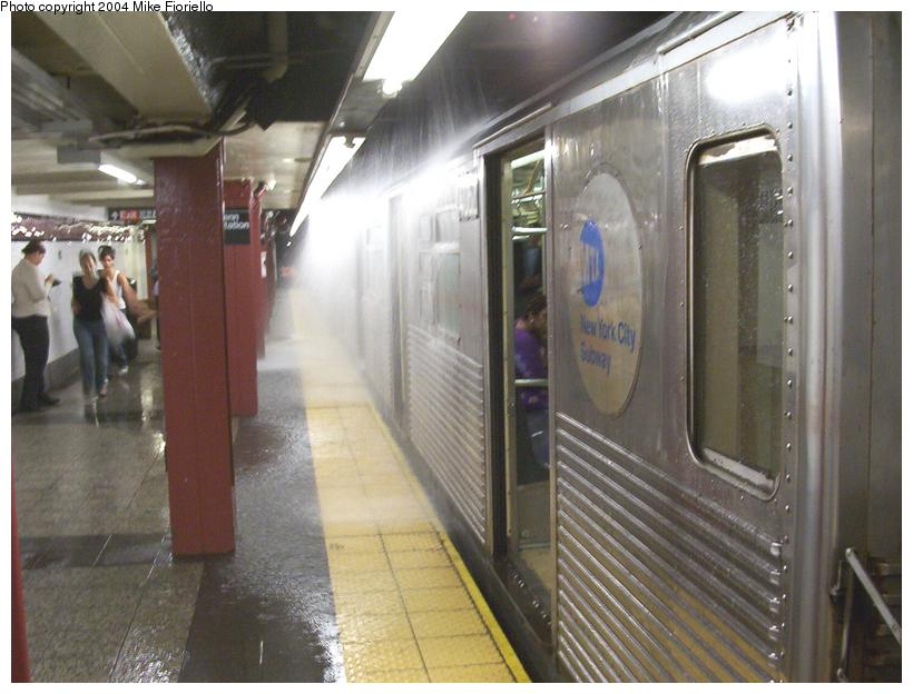 (72k, 820x624)<br><b>Country:</b> United States<br><b>City:</b> New York<br><b>System:</b> New York City Transit<br><b>Line:</b> IND 8th Avenue Line<br><b>Location:</b> 34th Street/Penn Station <br><b>Route:</b> C<br><b>Car:</b> R-38 (St. Louis, 1966-1967)  4062 <br><b>Photo by:</b> Mike Fioriello<br><b>Date:</b> 7/23/2004<br><b>Notes:</b> Note water pipe rupture above train<br><b>Viewed (this week/total):</b> 0 / 6230