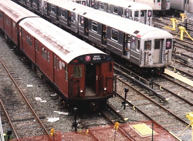 (258k, 775x566)<br><b>Country:</b> United States<br><b>City:</b> New York<br><b>System:</b> New York City Transit<br><b>Location:</b> Corona Yard<br><b>Car:</b> R-62A (Bombardier, 1984-1987)  1831 <br><b>Photo by:</b> Gary Chatterton<br><b>Date:</b> 8/24/2004<br><b>Notes:</b> With R33 9309<br><b>Viewed (this week/total):</b> 0 / 4131