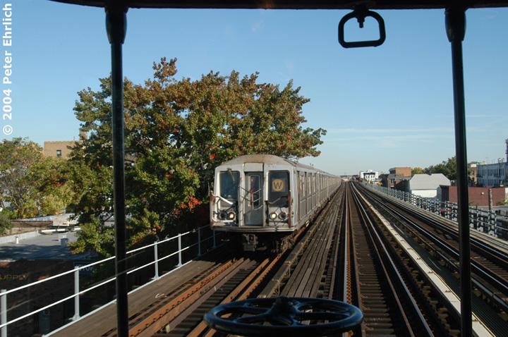 (174k, 720x478)<br><b>Country:</b> United States<br><b>City:</b> New York<br><b>System:</b> New York City Transit<br><b>Line:</b> BMT Astoria Line<br><b>Location:</b> Broadway <br><b>Route:</b> W<br><b>Car:</b> R-40 (St. Louis, 1968)   <br><b>Photo by:</b> Peter Ehrlich<br><b>Date:</b> 10/28/2004<br><b>Notes:</b> View from BU trainset.<br><b>Viewed (this week/total):</b> 0 / 3598