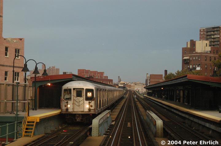 (126k, 720x478)<br><b>Country:</b> United States<br><b>City:</b> New York<br><b>System:</b> New York City Transit<br><b>Line:</b> BMT Nassau Street/Jamaica Line<br><b>Location:</b> Lorimer Street <br><b>Route:</b> M<br><b>Car:</b> R-42 (St. Louis, 1969-1970)  4566 <br><b>Photo by:</b> Peter Ehrlich<br><b>Date:</b> 10/27/2004<br><b>Viewed (this week/total):</b> 3 / 4117