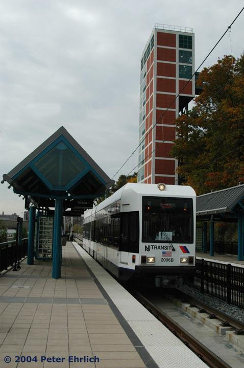(121k, 478x720)<br><b>Country:</b> United States<br><b>City:</b> Hoboken, NJ<br><b>System:</b> Hudson Bergen Light Rail<br><b>Location:</b> 9th Street <br><b>Car:</b> NJT-HBLR LRV (Kinki-Sharyo, 1998-99)  2006 <br><b>Photo by:</b> Peter Ehrlich<br><b>Date:</b> 10/27/2004<br><b>Notes:</b> Shows the massive elevator structure up to the top of the palisade.<br><b>Viewed (this week/total):</b> 1 / 2760