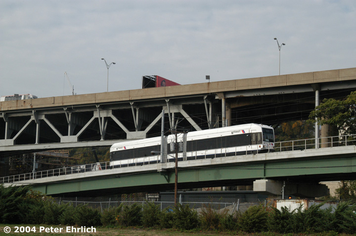 (124k, 720x478)<br><b>Country:</b> United States<br><b>City:</b> Weehawken, NJ<br><b>System:</b> Hudson Bergen Light Rail<br><b>Location:</b> Between Lincoln Harbor and Port Imperial <br><b>Car:</b> NJT-HBLR LRV (Kinki-Sharyo, 1998-99)  2009 <br><b>Photo by:</b> Peter Ehrlich<br><b>Date:</b> 10/27/2004<br><b>Notes:</b> North of Lincoln Harbor, the trains switch back after running about a half mile.<br><b>Viewed (this week/total):</b> 0 / 2717