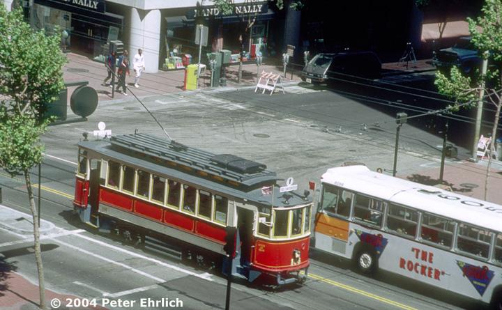(164k, 720x445)<br><b>Country:</b> United States<br><b>City:</b> San Francisco/Bay Area, CA<br><b>System:</b> SF MUNI<br><b>Location:</b> Market/2nd <br><b>Car:</b> SF MUNI Moscow/Orel Tram (built 1912) 106 <br><b>Photo by:</b> Peter Ehrlich<br><b>Date:</b> 7/4/1987<br><b>Notes:</b> View from Crocker Park.<br><b>Viewed (this week/total):</b> 0 / 936