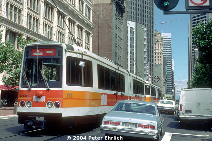 (197k, 720x480)<br><b>Country:</b> United States<br><b>City:</b> San Francisco/Bay Area, CA<br><b>System:</b> SF MUNI<br><b>Location:</b> Market/3rd/Geary/Kearny <br><b>Car:</b> MUNI Standard LRV (Boeing-Vertol, 1976-78) 1213 <br><b>Photo by:</b> Peter Ehrlich<br><b>Date:</b> 8/25/1985<br><b>Notes:</b> This was the only time a 2-car Boeing train ever operated on the surface of Market Street, a special charter. Transcending eras-- the last first-generation trolley coaches were retired by 1977, and the first Boeings didn't arrive until 1979.  But here it's 1985!<br><b>Viewed (this week/total):</b> 0 / 1152