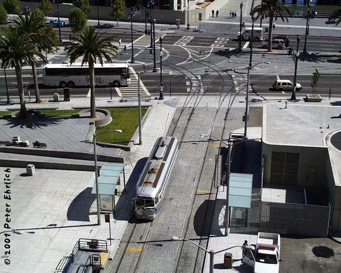 (206k, 675x540)<br><b>Country:</b> United States<br><b>City:</b> San Francisco/Bay Area, CA<br><b>System:</b> SF MUNI<br><b>Location:</b> Steuart/Don Chee Way <br><b>Car:</b> SF MUNI PCC (Ex-SEPTA) (St. Louis Car Co., 1947-1948)  1054 <br><b>Photo by:</b> Peter Ehrlich<br><b>Date:</b> 8/21/2001<br><b>Notes:</b> View from One Market Plaza terrace.<br><b>Viewed (this week/total):</b> 0 / 912