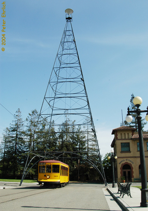 (142k, 504x719)<br><b>Country:</b> United States<br><b>City:</b> San Jose, CA<br><b>System:</b> Kelley Park Vintage Trolley <br><b>Car:</b>  143 <br><b>Photo by:</b> Peter Ehrlich<br><b>Date:</b> 3/28/2004<br><b>Notes:</b> The triangular tower is a smaller replica of the giant tower erected in downtown San Jose from the 1890s until 1915 to light the city.<br><b>Viewed (this week/total):</b> 0 / 1833
