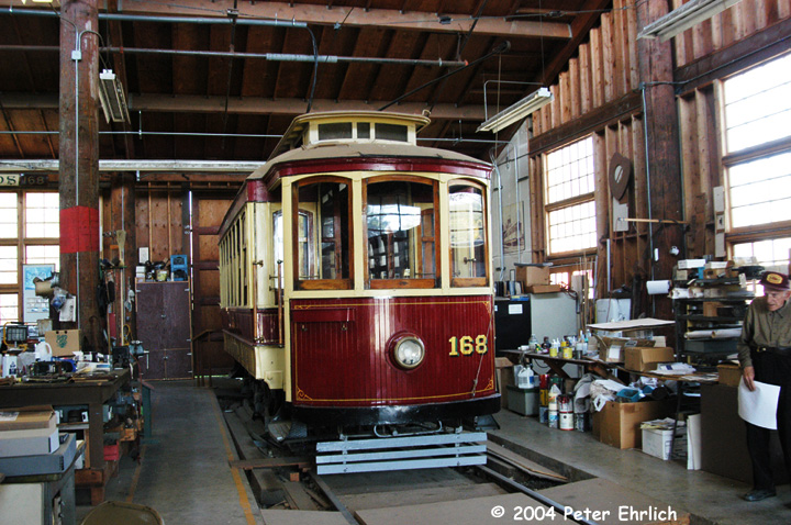 (192k, 720x478)<br><b>Country:</b> United States<br><b>City:</b> San Jose, CA<br><b>System:</b> Kelley Park Vintage Trolley <br><b>Car:</b> Porto Tram 168 <br><b>Photo by:</b> Peter Ehrlich<br><b>Date:</b> 3/28/2004<br><b>Notes:</b> Ex-Oporto 174, inside the San Jose Trolley & Railroad Corp.'s workshop.<br><b>Viewed (this week/total):</b> 0 / 1961