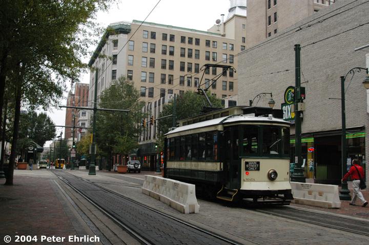 (180k, 720x478)<br><b>Country:</b> United States<br><b>City:</b> Memphis, TN<br><b>System:</b> MATA <br><b>Line:</b> Main St. Line <br><b>Location:</b> Madison & Main <br><b>Car:</b> Porto Tram 164 <br><b>Photo by:</b> Peter Ehrlich<br><b>Date:</b> 11/12/2004<br><b>Notes:</b> Main near Madison Avenue southbound.  Connection to Madison line on left.<br><b>Viewed (this week/total):</b> 0 / 2004