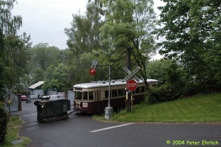 (190k, 720x478)<br><b>Country:</b> United States<br><b>City:</b> Portland, OR<br><b>System:</b> Willamette Shore Trolley<br><b>Car:</b>  813 <br><b>Photo by:</b> Peter Ehrlich<br><b>Date:</b> 5/15/2004<br><b>Notes:</b> One of the line's features is a number of road crossings which have operating wig-wag signals, such as this one at SW Macadam Road.<br><b>Viewed (this week/total):</b> 0 / 3599