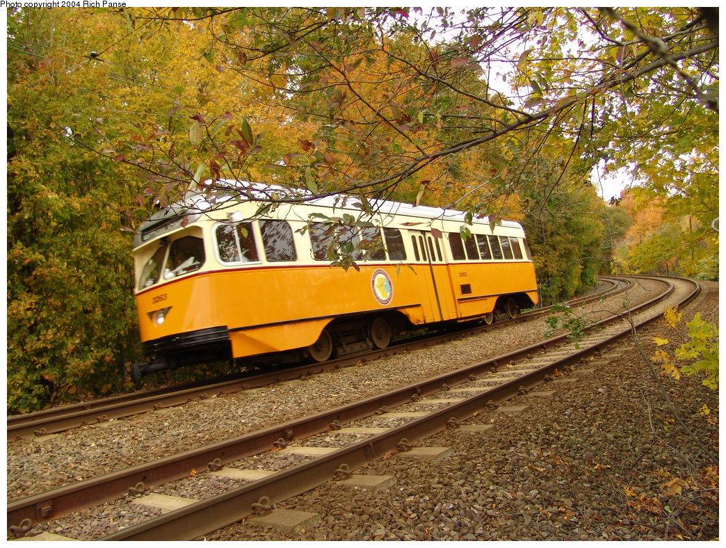 (357k, 1044x788)<br><b>Country:</b> United States<br><b>City:</b> Boston, MA<br><b>System:</b> MBTA<br><b>Line:</b> MBTA Mattapan-Ashmont Line<br><b>Location:</b> Cedar Grove <br><b>Car:</b> MBTA/BSRy PCC Wartime (Pullman-Standard, 1945-46)  3263 <br><b>Photo by:</b> Richard Panse<br><b>Date:</b> 10/24/2004<br><b>Notes:</b> Cedar Grove Cemetary in background.<br><b>Viewed (this week/total):</b> 3 / 2086
