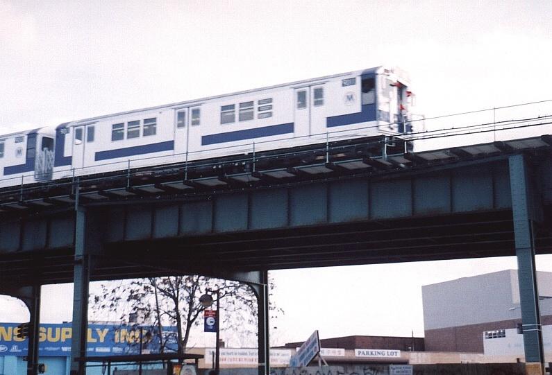 (182k, 795x541)<br><b>Country:</b> United States<br><b>City:</b> New York<br><b>System:</b> New York City Transit<br><b>Line:</b> IRT Flushing Line<br><b>Location:</b> 52nd Street/Lincoln Avenue <br><b>Route:</b> Fan Trip<br><b>Car:</b> R-33 Main Line (St. Louis, 1962-63) 9011 <br><b>Photo by:</b> Gary Chatterton<br><b>Date:</b> 11/28/2004<br><b>Notes:</b> R33/SMEE train of many colors in holiday 7 line service.<br><b>Viewed (this week/total):</b> 0 / 3943