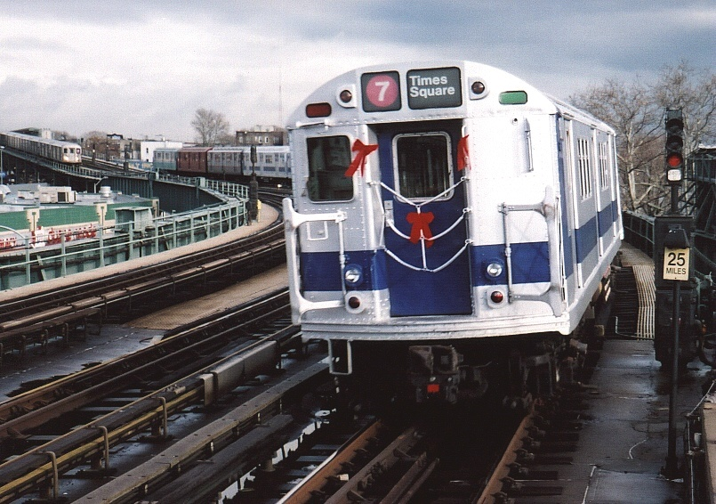 (230k, 805x566)<br><b>Country:</b> United States<br><b>City:</b> New York<br><b>System:</b> New York City Transit<br><b>Line:</b> IRT Flushing Line<br><b>Location:</b> 46th Street/Bliss Street <br><b>Route:</b> Fan Trip<br><b>Car:</b> R-33 Main Line (St. Louis, 1962-63) 9011 <br><b>Photo by:</b> Gary Chatterton<br><b>Date:</b> 11/28/2004<br><b>Notes:</b> R33/SMEE train of many colors in holiday 7 line service.<br><b>Viewed (this week/total):</b> 2 / 4138
