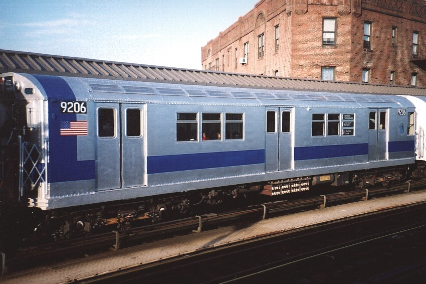 (230k, 850x566)<br><b>Country:</b> United States<br><b>City:</b> New York<br><b>System:</b> New York City Transit<br><b>Line:</b> IRT Flushing Line<br><b>Location:</b> 52nd Street/Lincoln Avenue <br><b>Route:</b> Fan Trip<br><b>Car:</b> R-33 Main Line (St. Louis, 1962-63) 9206 <br><b>Photo by:</b> Gary Chatterton<br><b>Date:</b> 11/28/2004<br><b>Notes:</b> R33/SMEE train of many colors in holiday 7 line service.<br><b>Viewed (this week/total):</b> 5 / 2730