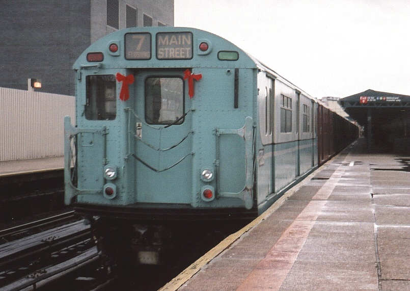 (197k, 805x571)<br><b>Country:</b> United States<br><b>City:</b> New York<br><b>System:</b> New York City Transit<br><b>Line:</b> IRT Flushing Line<br><b>Location:</b> Court House Square/45th Road <br><b>Route:</b> Fan Trip<br><b>Car:</b> R-33 World's Fair (St. Louis, 1963-64) 9306 <br><b>Photo by:</b> Gary Chatterton<br><b>Date:</b> 11/28/2004<br><b>Notes:</b> R33/SMEE train of many colors in holiday 7 line service.<br><b>Viewed (this week/total):</b> 1 / 2762