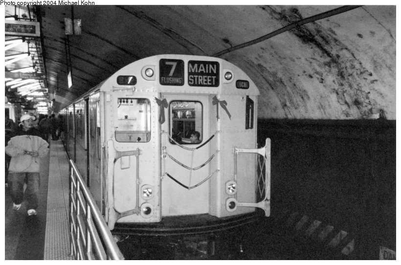 (100k, 820x542)<br><b>Country:</b> United States<br><b>City:</b> New York<br><b>System:</b> New York City Transit<br><b>Line:</b> IRT Flushing Line<br><b>Location:</b> Grand Central <br><b>Route:</b> Fan Trip<br><b>Car:</b> R-33 World's Fair (St. Louis, 1963-64) 9306 <br><b>Photo by:</b> Michael Kohn<br><b>Date:</b> 11/28/2004<br><b>Notes:</b> R33/SMEE train of many colors in holiday 7 line service.<br><b>Viewed (this week/total):</b> 1 / 4161