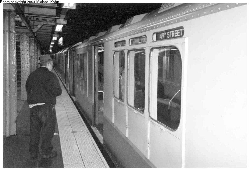(73k, 820x559)<br><b>Country:</b> United States<br><b>City:</b> New York<br><b>System:</b> New York City Transit<br><b>Line:</b> IRT Flushing Line<br><b>Location:</b> Times Square <br><b>Route:</b> Fan Trip<br><b>Car:</b> R-12 (American Car & Foundry, 1948) 5760 <br><b>Photo by:</b> Michael Kohn<br><b>Date:</b> 11/28/2004<br><b>Notes:</b> R33/SMEE train of many colors in holiday 7 line service.<br><b>Viewed (this week/total):</b> 1 / 4327