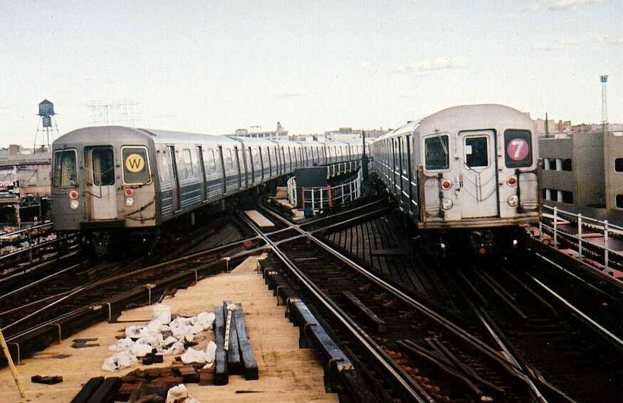 (54k, 875x566)<br><b>Country:</b> United States<br><b>City:</b> New York<br><b>System:</b> New York City Transit<br><b>Line:</b> BMT Astoria Line<br><b>Location:</b> Queensborough Plaza <br><b>Route:</b> N<br><b>Car:</b> R-68A (Kawasaki, 1988-1989)  5164 <br><b>Photo by:</b> Gary Chatterton<br><b>Date:</b> 8/2/2002<br><b>Notes:</b> With R62A 2100 on #7<br><b>Viewed (this week/total):</b> 2 / 5227