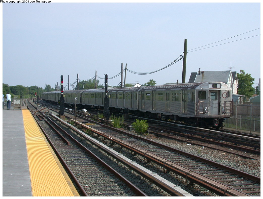 (211k, 1044x788)<br><b>Country:</b> United States<br><b>City:</b> New York<br><b>System:</b> New York City Transit<br><b>Line:</b> IND Rockaway<br><b>Location:</b> Howard Beach <br><b>Route:</b> A<br><b>Car:</b> R-38 (St. Louis, 1966-1967)  4084 <br><b>Photo by:</b> Joe Testagrose<br><b>Date:</b> 7/17/2004<br><b>Viewed (this week/total):</b> 0 / 4052